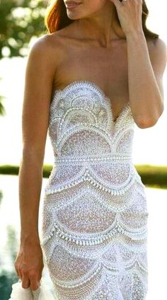 Beaded white lace wedding gown