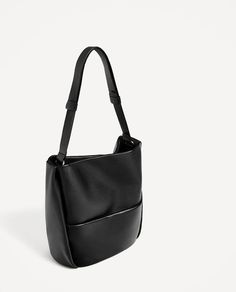ZARA - WOMAN - LARGE SOFT LEATHER BUCKET BAG $139 Black Black leather bucket bag with lining with pocket, outer pocket with magnetic clasp fastening and long shoulder strap. Fastens with magnetic clasp fastening.  Height x Width x Depth: 33 x 37 x 16 cm. / 12.9 x 14.5 x 6.2″