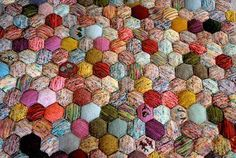 Pattern for little poofy hexagons you make individually and join together. I like how versatile this is. You can make a quilt, rug, catbed, anything thick or squishy.