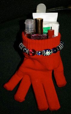 cute gift idea! looks like hand sanitizer, nail polish, nail file, in a glove with a bracelet. I might add hand lotion and the other glove.