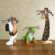 """Peepers® Eyeglass Holders    Live on the wild side with these spectacular spec keepers. Carved of wood, each clever critter has a glasses-holding slot on top. * Dog Peepers® Eyeglass Holder (7 1/2"""" tall) * Giraffe Peepers® Eyeglass Holder (9 3/4"""" tall) * Frog Peepers® Eyeglass Holder (4 1/2"""" tall)"""