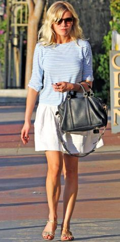 Look of the Day › October 23, 2011 WHAT SHE WORE Dunst shopped in L.A. sporting a striped top with a full skirt.