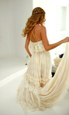 Cute boho bride... I love the dress and the way she did her hair...