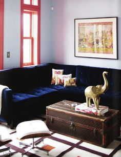 Blue sofa, trunk coffee table