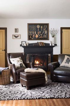 This cozy living room looks like the perfect place to relax this fall thanks to its rustic fireplace.