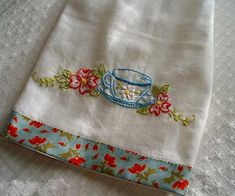 Embroidered teatowel - love the edging. I need to do some stitchery, these would make great Christmas presents