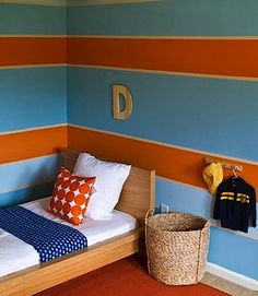 Complementary: The high intensity of the colors on the walls make the kids room feel very energetic. But they didn't use a good balance of color. Their seems to be an equal amout of orange and blue.