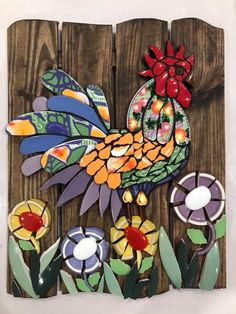 Mosaic on timber. Rooster