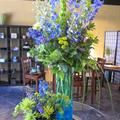 The blue, purple and green hues in this arrangement make it the perfect springtime bouquet.