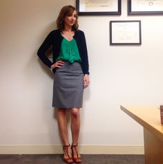 navy cardigan, emerald top, gray trousers or skirt