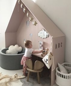 A lovely way to zone a kids bedroom while providing a nice bit of feature block colour and a play desk. #kidsdecor