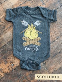 "Dress up your outdoorsy babe in this adorably printed jumper, decorated with two familiar sights: roasting marshamallows and campfire. The center reads, ""Happy Camper,"" in vintage-inspired letters, and the hand-illustrated design is printed on super soft triblend fabric. #babyclothes"