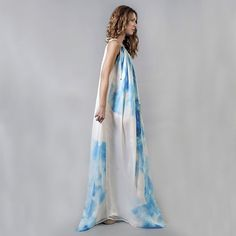 This unique piece is easily worn on beach as well as going out. It is made of beautiful sheer silk chiffon with silk satin lining. This beautiful lightweight fabric is in the natural fiber color / natural white.  Each item is hand painted by the designer/artist Rania Remoundou. It takes not less than 4 hours of hand painting to complete each piece. Each one is unique and one of a kind. Colors used in hand painting process are different shades of blue, yellow and black which mix on fabric to…