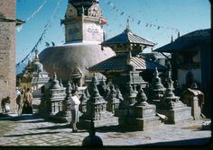 1958, my mom at the Swayambhunath in the Kathmandu Valley. One of the most sacred Buddhist sites in Nepal, it is also revered by Hindus. Swayambhunath is also known as the Monkey Temple as there are holy monkeys there. They are holy because Majusri, the bodhisattva of wisdom and learning was raising the hill which the Swayambhunath Temple stands on. He was supposed to leave his hair short but he made it grow long and head lice grew. The head lice had transformed into monkeys.