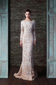 Rami Kadi 2014 Le Gala Des Mysteres Collection. Beautiful long nude colored dress covered with white details. The dark lips and eyeshadow add to the glamour.