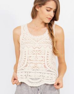 Tribal embroidered mesh top.