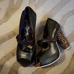 Irregular Choice Brand Chunky heels Fabulous Irregular Choice Brand Chunky heels they have a metallic brown and gold shoe with a Velcro strap and a cheetah heel that is fake hair were these a few times Boutique purchase size 8 run the show just cleaning out my closet Irregular Choice  Shoes Heels