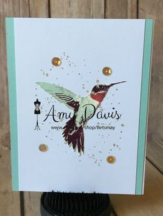 This card has a very pretty hummingbird as the focal point. The color theme is pool party from Stampin Up!. The hummingbird itself is a 3-step stamp, then I added splatter spots in the background and then gold sequins to set everything off. I can add a banner or sentiment on the front if you like. The inside is blank and ready for your handwritten sentiment or a stamped sentiment of your choice prior to mailing. I have 2 of these cards and they similar but do have a few differences. It is…