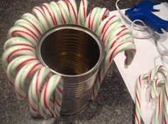 Turn candy canes and a can into a vase.