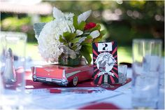 This is so cute, I love the vintage toy car being used as a vase. Amazing idea to present your theme, so unique!