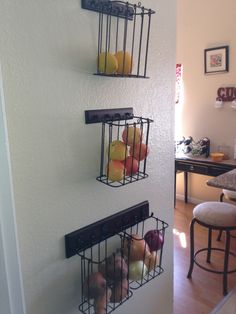 Found the wire baskets at Cost Plus on sale for 5 dollars each, removed handles and hung them on the wall using Key Hook hangers found at Target for 6 dollars. This got the potatoes and onions and fruit off the top of the fridge and on the counters and used the space on the wall. Was able to do this cheaper than the pottery barn baskets or any other options I found online. I like how it turned out!