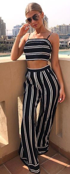 #spring #outfits woman standing wearing white and black striped crop top and pants. Pic by @jesshunt2