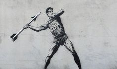 Banksy is back with two new pieces of street art ahead of this year's London 2012 Olympic Games. The new graffiti works see a javelin thrower with a missile and a pole vaulter hurdling barbed wire. Banksy Graffiti, Street Art Banksy, Graffiti Games, Banksy Artwork, Banksy Canvas, Bansky, Graffiti Artists, Banksy Paintings, Pop Art