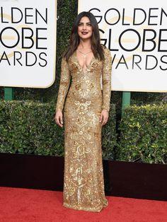 Priyanka Chopra in a Ralph Lauren dress and Lorraine Schwartz jewelry attends the Golden Globe Awards 2017