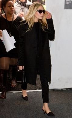 fall into black/ easy for travel, rushed moments.  Perfect ankle pants, lovely slides, great glasses, love her messy hair xx
