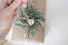Slide key tag onto jute twine | DIY Décor: Add cedar mini-wreath to your holiday gift wrap