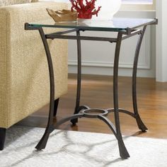 Hammary Sutton Rectangular Glass top End Table - Bring home the polished look of the Hammary Sutton Rectangular Glass top End Table . Crafted of glass and metal and with dark burnished frames, this...