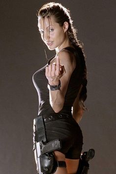 Lara Croft: The Inspiration: Angelina Jolie used her tough-girl qualities to play a perfect Lara Croft in Tomb Raider. Tomb Raider Angelina Jolie, Lara Croft Angelina Jolie, Angelina Joile, Tomb Raider Costume, Jolie Pitt, Celebs, Celebrities, Brad Pitt, Hollywood Actresses