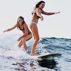two girls surfing | re-pinned by http://www.wfpblogs.com/author/nicolerichards…