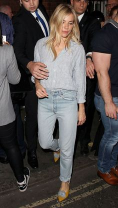 Miller stepped out in straight-leg jeans and a striped shirt, pairing her ensemble with tan and pale blue shoes.