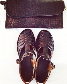 Leather sandals and woven leather clutch
