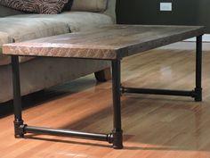 This coffee table very simple yet exquisitely beautiful. The top consists 5 separately joined planks of Salvaged Douglass fir with a great dark brown