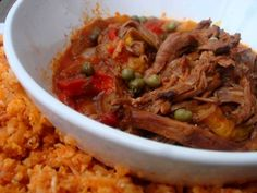 Crockpot Ropa Vieja with Cuban Style Rice  - Ropa Vieja is naturally low carb but what is surprising is the low carb rice recipe.  Made with cauliflower, even Cuban rice can be on my list of food to eat!   A Paleo recipe