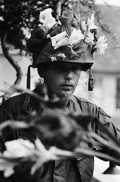 11 Apr 1968, Saigon, Vietnam --- 4/11/1968-Saigon, Vietnam: Sergeant Daniel Lederman of Miami, FL, keeps the season in perspective with his helmet decorated in Easter-type flowers April 11. Lederman's outfit, the 25th Infantry Division, is participating in Operation Complete Victory in the III Corps area. --- Image by © Bettmann/CORBIS