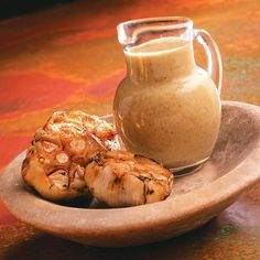 Roasted Garlic Vinaigrette Recipe -Our Test Kitchen came up with this full-flavored vinaigrette. Roasted garlic is blended with Italian seasoning, Dijon mustard, tarragon vinegar and lemon juice in the zesty dressing. Try it drizzled over crisp greens or cherry tomatoes.