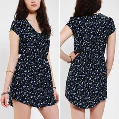NWOT Urban Outfitters dark blue floral dress This dress is perfect for the spring/summer! It is a gorgeous midnight blue color with a cutesy floral pattern! It features a scoop neck, with buttons halfway down. Also has a cinched waist for a flattering fit! Excellent condition, only worn maybe twice! Price is FIRM, unless bundled! :) Kimchi Blue Dresses