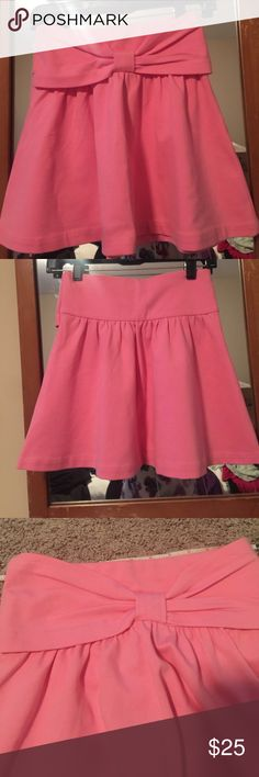 "Kate Spade pink skirt NWT. Super adorable pink Kate Spade girls ""kammy"" skirt.  Adorable bow details. Perfect for summer. Pull on style. Size medium. 12 inch flat waist with slight stretch . 15 inches long. Machine washable and tumble try low. 67 rayon 28 nylon 5 elastin kate spade Bottoms Skirts"