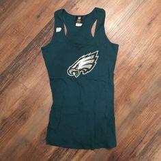 Philadelphia Eagles NFL tank top Philadelphia Eagles NFL teal tank top.  Wife beater material. NWT- has silver NFL sticker on top. NFL Tops Tank Tops