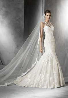 Beige tulle mermaid-style wedding dress | PRONOVIAS | https://www.theknot.com/fashion/pladie-pronovias-wedding-dress