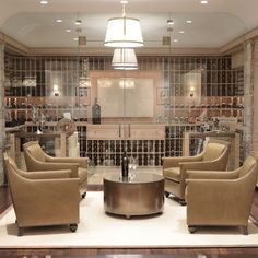 Giannetti Home: Chic basement wine cellar with seamless glass doors and exposed brick walls. Wine cellar ... ♠ re-pinned by http://wfpcc.com/waterfrontpropertieslistings.php #WineCellar