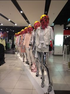Lined-up mannequins with flower heads at Topshop.