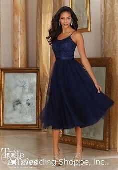 A romantic and flirty bridesmaid dress with a lace bodice and a tea-length tulle skirt.