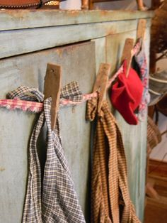 Fabrics pinned onto a fabric clothesline..... Thanks for the great idea!!!