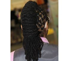 twisted back locs... cool for those with long locks