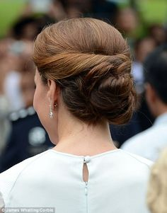 The Duchess's trademark tumbling locks were swept up into a 1940s-style up-do