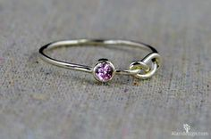 These thin sterling infinity knot rings make a stunning fashion statement! This thin silver band is set with a dainty Pink Tourmaline conflict free cubic zircon - October's birthstone! These rings Bff Rings, Knot Rings, Jewelry Rings, Jewellery, Silver Pendant Necklace, Sterling Silver Jewelry, Infinity Knot Ring, Silver Stacking Rings, Stackable Rings